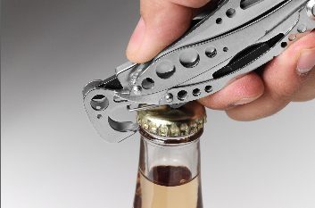 Multi-purpose tool opening a bottle